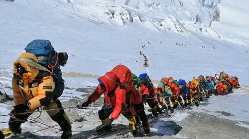 There is effectively no limit on how many people can climb Mount Everest at once.