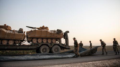 Turkish soldiers prepare to enter Syria.