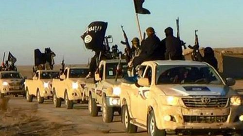 Islamic State fighters travelling through the so-called caliphate, pictured in 2013.