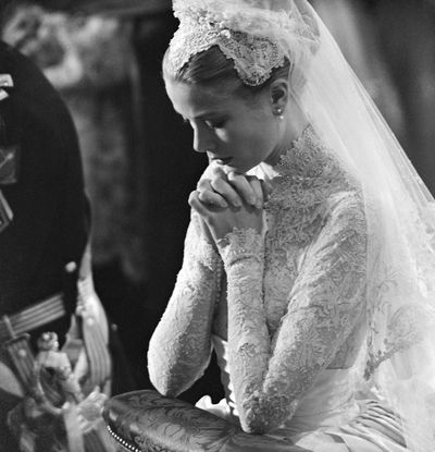 """<p>Princess Grace and Prince Rainer of Monaco, 1956</p> <p>Dress: Helen Rose, MGM Studios</p> <p>The dress, which has been compared to that of the Duchess of Cambridge, was a gift from MGM and took 30&nbsp;seamstresses six weeks to make using 125-year-old rose point Brussels lace and&nbsp;a silk faille skirt with&nbsp;three petticoats.</p> <p>""""On her wedding day, Grace Kelly gave new meaning to the word icon,"""" the late designer Oscar de la Renta said.</p> <p> """"Her whole look, from the regal veil to the feminine lace details and the conservative gown, made her an ageless bride.""""&nbsp;</p>"""