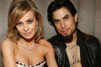 """Bored on a flight to Miami one day, Carmen Electra and Dave Navarro created a bit of their own inflight entertainment…<br/><br/>""""We worked it out that I would go in first,"""" Carmen confessed in 2003. """"And Dave would come along after and give a secret knock. Then I let him in and, well, the rest is history.""""<br/><br/>(Image: Getty)"""