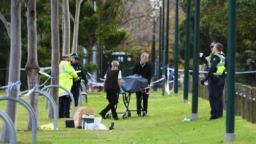 Investigators at the oval in which Ms Dixon's body was found on June 13.