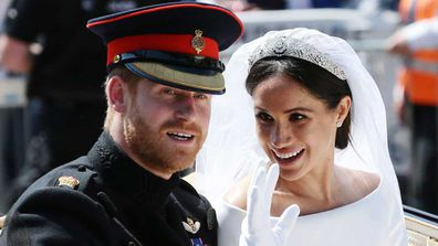 "Meghan Markle and Prince Harry on their wedding day<span style=""white-space:pre;"">	</span>"
