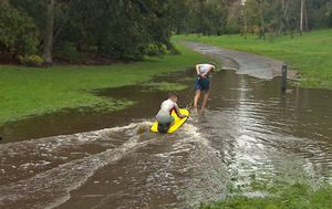 Melbourne receives biggest October downpour in a decade as Queensland gets first spring soaking of the year
