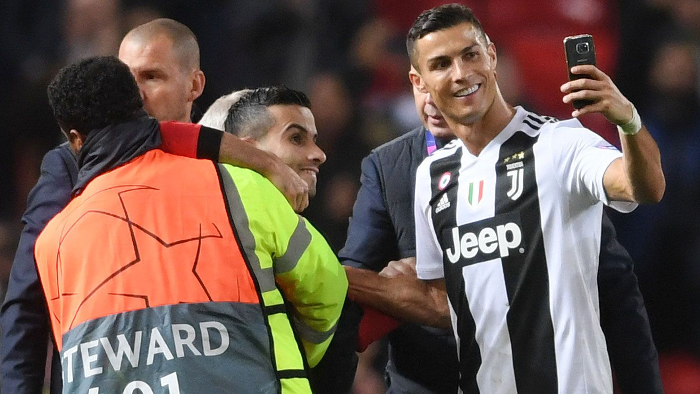 Ronaldo takes selfie with pitch invader on winning return to Manchester United