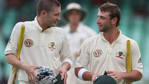 Former Australian captain Michael Clarke with Hughes. (AAP)