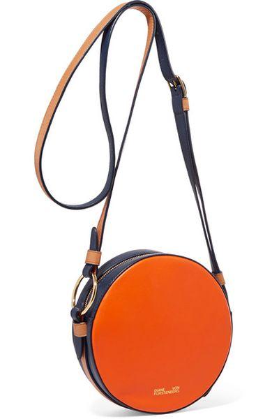 "<p><a href=""https://www.net-a-porter.com/au/en/product/938262/diane_von_furstenberg/circle-color-block-leather-and-calf-hair-shoulder-bag"" target=""_blank"">Diane Von Furstenberg Circle Colour-Block Leather and Calf Hair Shoulder Bag, $346.84</a></p>"