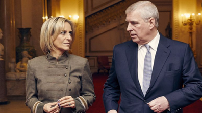 Emily Maitlis from BBC Newsnight walking with Prince Andrew ahead of their sit-down intervi