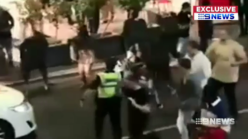 Police were able to stop the violent brawl on a busy Adelaide street by using capsicum spray on the alleged offenders.