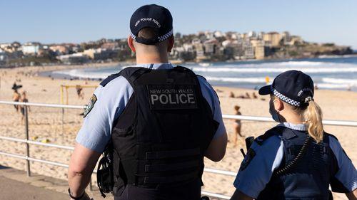Police patrol Bondi Beach during Sydney's latest COVID-19 lockdown.