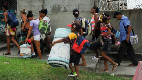 Residents of the Cuban community of Cecilia were evacuated ahead of the storm. (AFP)