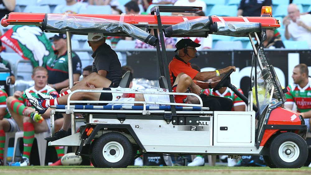 St George Illawarra's Will Matthews being taken from the field after breaking his hip against South Sydney in the Charity Shield. (Getty)