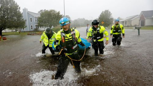 Rescuers search for people who did not evacuate before Florence barrelled through.