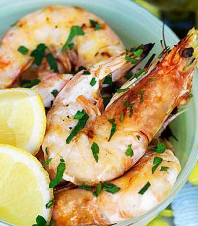 Barbecued king prawns with lemon and parsley