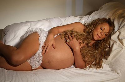 Mariah Carey's obligatory naked while pregnant photo shoot had her sleeping in white lace and little else for Life&Style magazine.
