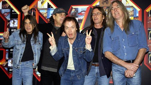 Malcolm Young, Brian Johnson, Angus Young, Phil Rudd and Cliff Williams from AC/DC pose for photographers in March 2003. (AAP)