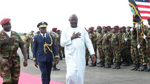 Liberian President George Weah (right) has ordered an investigation.
