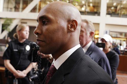 Mohamed Noor arriving at court to learn he will face trial for fatally shooting Justine Ruszczyk last July.
