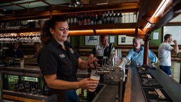 Jennifer Rounds pouring last drinks at Fortune of War, Sydney's oldest pub prior to closing its doors on March 23.