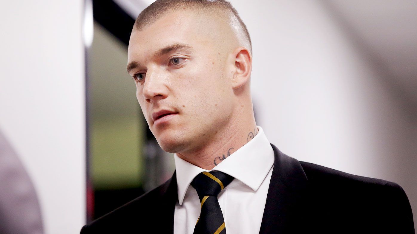 Dustin Martin issues apology, fined by the AFL for 'obscene gesture'