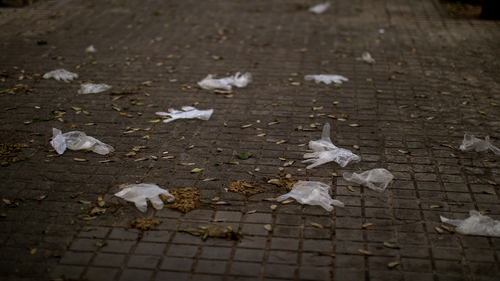 Discarded plastic gloves lay on the ground in a street in downtown Barcelona, Spain, Friday, May 1, 2020 as the lockdown to combat the spread of coronavirus continues.