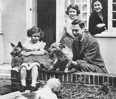 The Queen with her father the King and their dogs