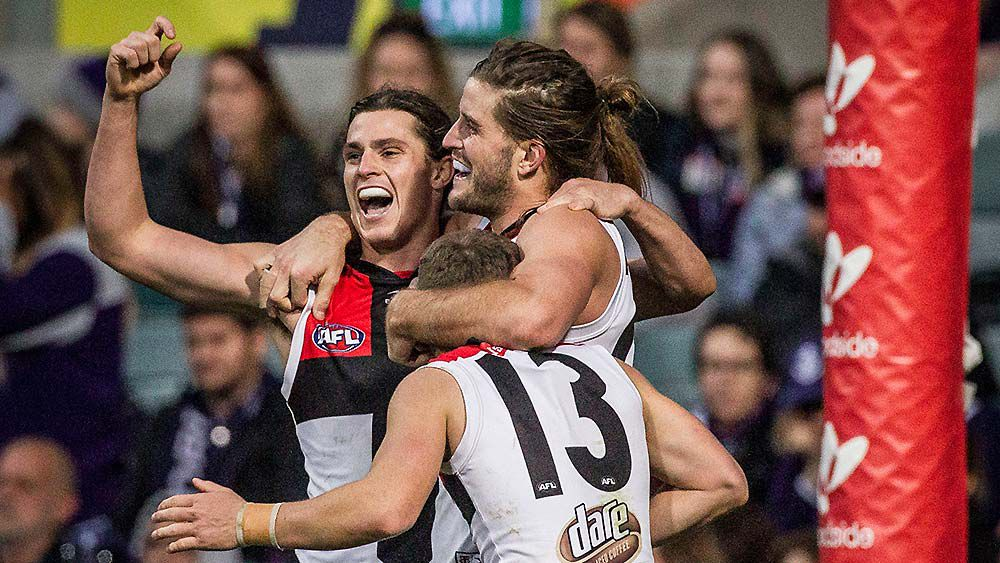 Josh Bruce of St Kilda (centre) celebrates St Kilda's win