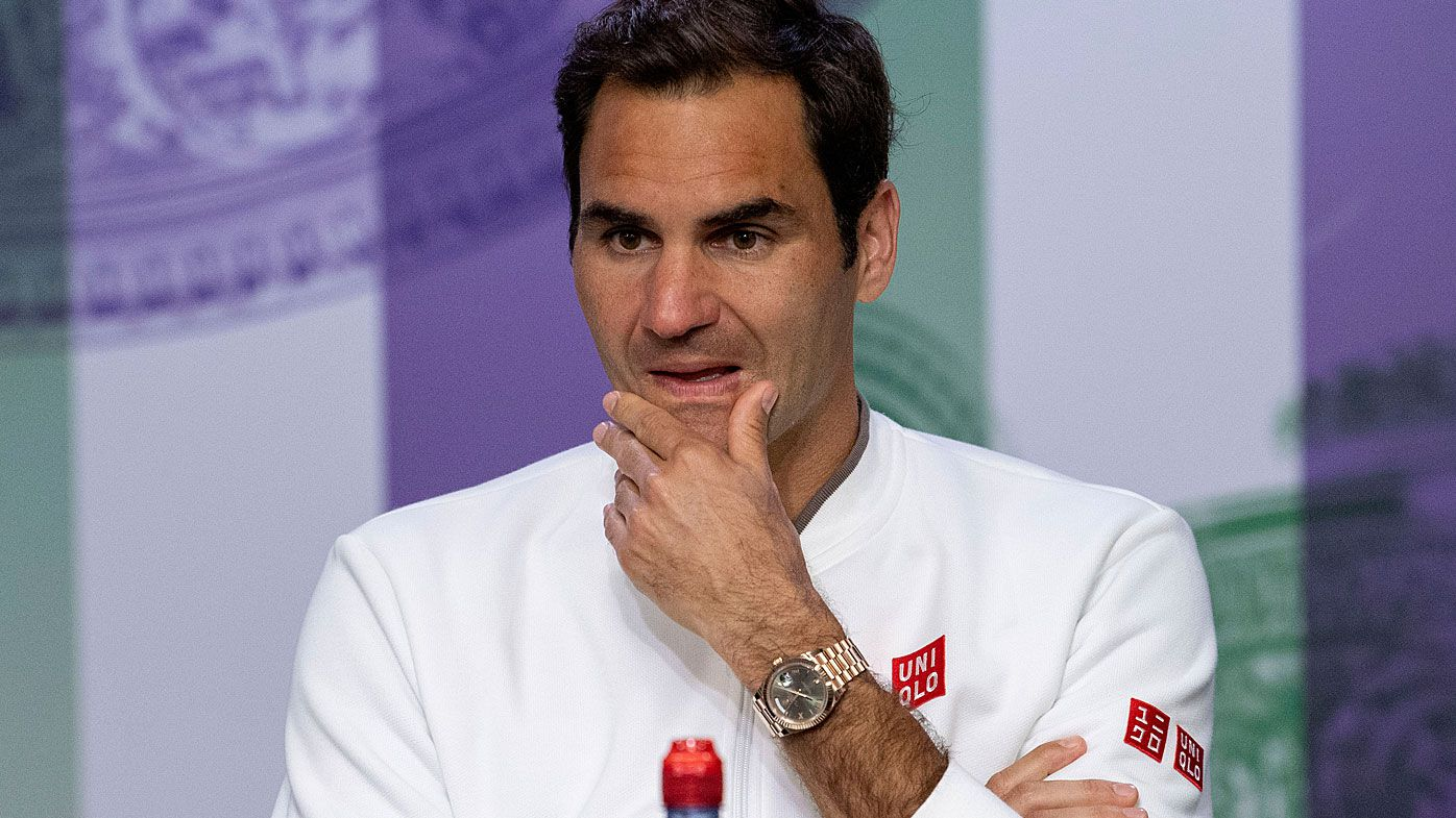 Switzerland's Roger Federer reacts during the press conference