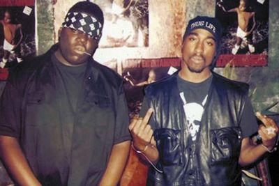 Both superstar rappers were gunned down, six months apart, while inside a car waiting at a red light. <P>Both were hit four times, and no arrests were made over either killing.<P> Biggie's family brought a civil case against record label boss <b>Suge Knight</b>, claming he orchestrated the murder - while Tupac's fans believe he is still alive, pointing out clues in his posthumously-released albums.