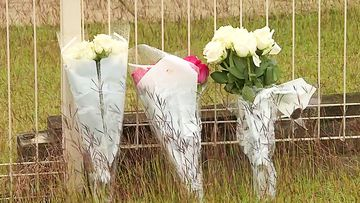 Floral tributes have continued to grow overnight following the death of a Maryborough mother after she was attacked by three dogs.