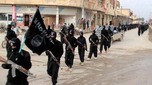 This undated photo published in 2014 shows IS militants marching in the capital Raqqa. (AAP)