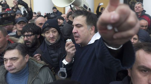 Mikheil Saakashvili addresses the crowd after he was released. (AAP)