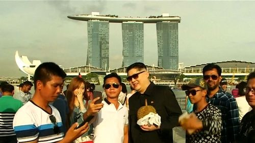 Howard stops and poses for photos in Singapore. Picture: 9NEWS