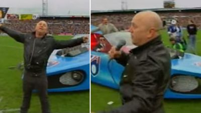 "Nothing says AFL Grand Final quite like Angry Anderson on a blue Batmobile, performing ""Bound For Glory"" at the 1991 Premiership. (YouTube)"