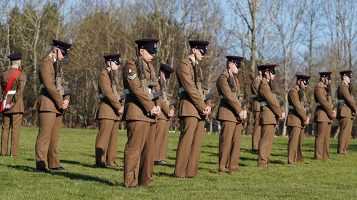 (EDITOR'S NOTE: No reuse after 11.59pm on March 6th 2021 without written consent from gemma@captaintom.org.) Members of the Armed Forces stand in formation during a private funeral service for Captain Sir Tom Moore at Bedford Crematorium on February 27, 2021 in Bedford, England.