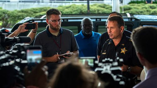 Jacksonville Sheriff Mike Williams has described the suspect as a white man, found dead at the scene.