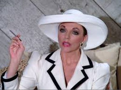 <p>Forget the sappy storylines. The real star of this hit &lsquo;80s drama was the show&rsquo;s fabulous yet flawed villain, Alexis Colby (played by Joan Collins).</p> <p>Favouring purples, black, white and large hats. Colby&rsquo;s wardrobe choices defined glamourous, OTT &lsquo;80s fashion.</p> <p>&nbsp;</p>