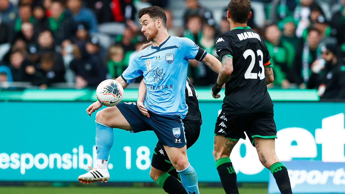 Alexander Baumjohann of Sydney FC controls the ball