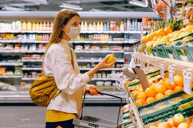 Woman in face mask at grocery store