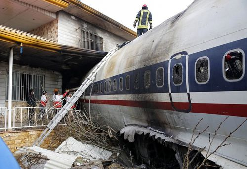 The Boeing 707 crashed through a wall and ploughed into a residential area not far from Fath Airport.