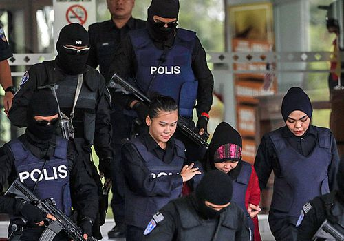 Siti Aisyah, of Indonesia, who is detained in connection with the death of Kim Jong-Nam, is escorted by heavily armed police from the Malaysian high court earlier this month. (Photo: AP).