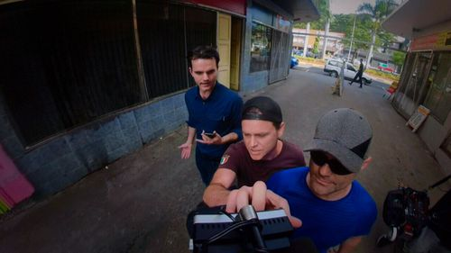 Danny Nikolic, the brother of a man facing drugs charges in Fiji, grabs the news camera. Picture: ACA