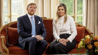 The king and queen of the Netherlands apologise for a recent family holiday to Greece.