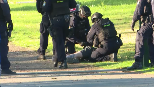 Police arrested the man after he surrendered to officers this afternoon.