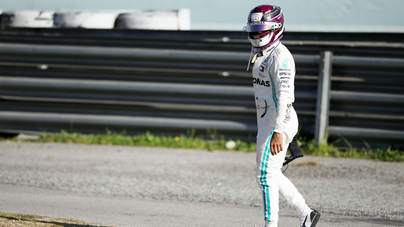 Lewis Hamilton of Great Britain and Mercedes GP walks on a circuit road after his car stopped on track during Day Two of F1 Winter Testing