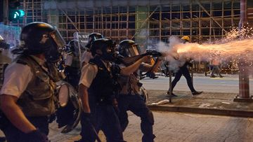 Police fire tear gas to disperse protesters attending an anti-government rally
