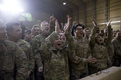 US troops applaud following the President's talk.