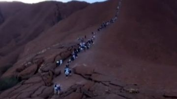 Hundreds queued up to climb Uluru.