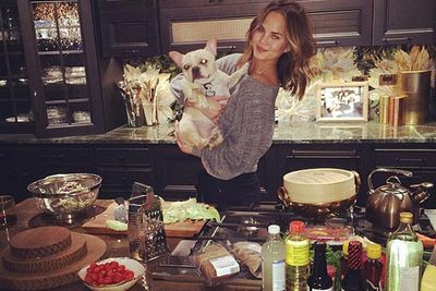 @chrissyteigen: Friday night in! Making spicy tuna hand rolls, a sesame dressing salad and broiled shrimp! (dog not being served)