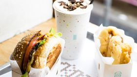 8Bit's burger with cheese, beer battered onion rings and peanut butter milkshake